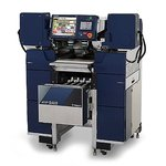 Machines for packing in trays